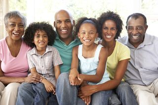 Bigstock-Extended-Family-Relaxing-On-So-13907567 (1)